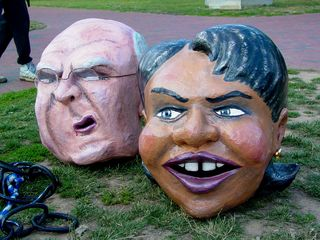 The oversized Bush, Rumsfeld, Cheney, and Rice heads sit on the ground, awaiting the time when they will be put to use.