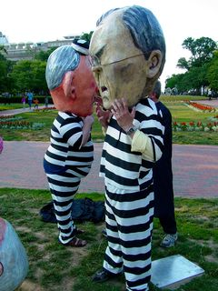 Meanwhile, the person portraying Donald Rumsfeld, as well as the original person playing George W. Bush, put on their prison stripes and got their heads in place.