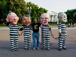 A number of people also took a moment to pose for photos with the people portraying Bush, Cheney, Rumsfeld, and Condoleezza Rice.