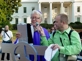 David Barrows conducts the exorcism on the White House, while many look on and join in.