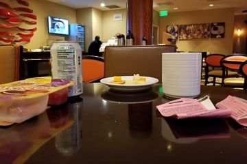"""We found our way up to the Dulles Airport Marriott later that evening, where we snuck into the Bonvoy lounge. We were cool about it, having a light meal while there, and discussing """"traveling back to our homes in Missouri""""."""