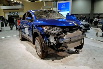 A Honda HR-V that was used in a crash test. They even showed a video of the crash test itself show how what we saw was done. Considering that I own a vehicle very similar to this, I found it comforting that while the mechanical areas awere smashed up, the cabin, where I would be, was more or less intact.