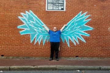 """Later on, we went to downtown Frederick, where we posed with some wings that had been painted in chalk on a building wall for the """"Fire in Ice"""" festival that had recently been held."""