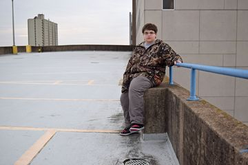 Elyse poses for a photo on the roof of a parking garage in downtown Harrisburg.