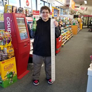 On March 4, prior to going up to Baltimore, we stopped at the CVS store near the house so that Elyse could get a drink. Here, Elyse shows off the receipt that is nearly as tall as she is, which she got for a single bottle of ginger ale.
