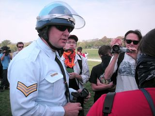 A Park Police officer explains the regulations regarding demonstrations around the Washington Monument. To his credit, this particular officer, C.R. Holmberg, was extremely polite and professional with us - nothing less than a gentleman.