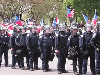 Soon after the Nazis emerged, the police got into formation around the Nazis, and the march was ready to begin.