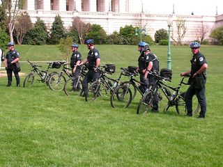 Police officers in full riot gear lined the walkway making sure that we did not interfere with the Nazis' rally, and bike cops took up positions on the other side of us.