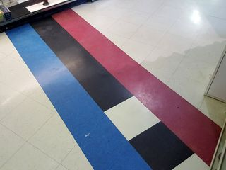 The border, marked along the floor, with the blue side in North Carolina, and the red side in Virginia.