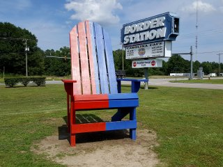 Adirondack chair straddling the border, with the red-painted side in Virginia, and the blue-painted side in North Carolina.