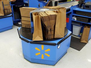 Unike most stores, the bagging wheels at this Walmart store are outfitted for paper bags instead of plastic. This is due to a ban on plastic bags that was enacted in 2009 for the Outer Banks, affecting Bodie, Hatteras, and Ocracoke Islands, i.e. from Corolla all the way down to Ocracoke.