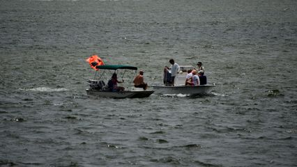 Two groups on powerboats, out fishing.