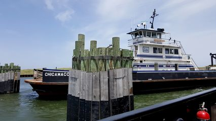 Berthing at Ocracoke. TheChicamacomico, another Hatteras-class ferry, is nearby. I remember watching theChicamacomico carrying a truck containing hazardous materials across by itself in 1996. I could only assume that the hazmat designation required that the truck travel solo.