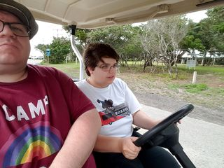 I used the selfie camera on my phone to get a photo of Elyse driving the golf cart. Yes, she's really driving it!