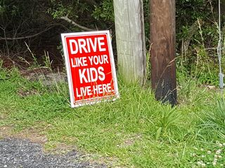 """""""Drive like your kids live here"""" sign. I find these signs to be some of the most obnoxious things that you can post along the side of the road."""