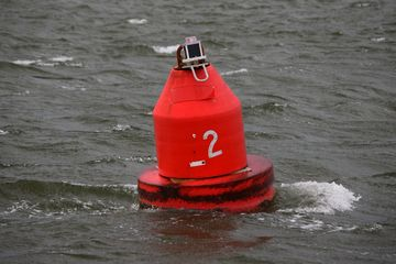 Buoys and such in the water.