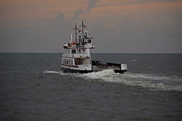 TheHatteras passes us, sailing mostly empty towards Ocracoke.