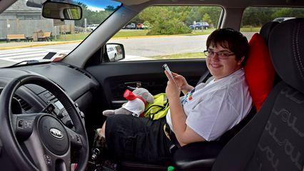 Elyse, in the car.