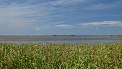 Currituck Sound, separating Corolla from the mainland. The mainland is visible in the distance.