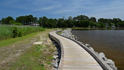 Wooden walkway along the water's edge.
