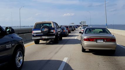 Traffic backup leading up to and on the bridge.