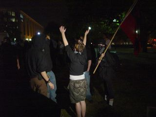 By the appointed time, a crowd had assembled in Washington Circle, most dressed in full black bloc.