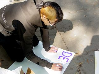A number of people took a moment to make signs in the park.