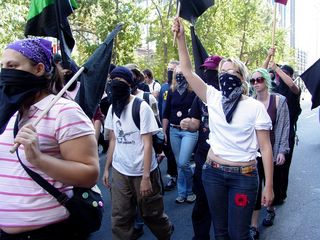 Part of the black bloc marches through the streets...