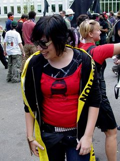 After quickly breaking through one row of police tape designed to keep us in Murrow Park and off the street, one of the radical cheerleaders added the police tape to her outfit as a bit of an accent.
