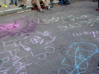 Meanwhile, the street next to the park was covered with chalk drawings...