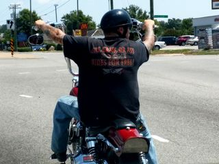 """The motorcycle guy and his shirt: """"Gas, grass, or ass: no one rides for free!"""""""