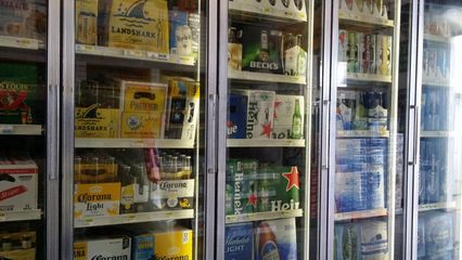 Coolers, mostly containing bottled beer, lined one wall of the store.