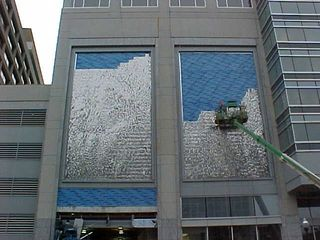 A new building is going up at 1801 N. Lynn Street!  Here, workers put a waving art piece over the building's entrances...