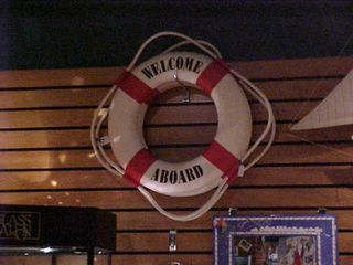"""This was kind of eerily reminiscent of my fourth floor door decorations in Potomac Hall that year, which had a life ring just like this with """"Welcome aboard!"""" beneath it."""