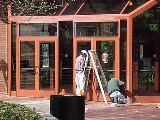 Over at the Omni Hotel in Charlottesville, workmen paint the door frames that special Omni color...