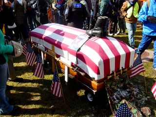 One group had a flag-draped coffin, topped by the boots and photo of what is presumably a fallen serviceman.