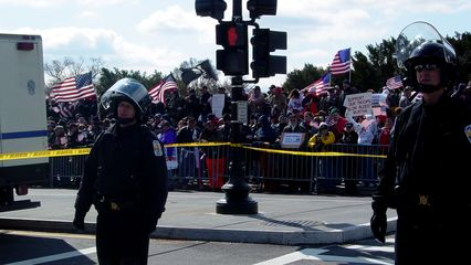 The counter-protesters were out in force, separated from the anti-war group by barriers and caution tape. Additionally, a row of Park Police officers enforced something of a no man's land between the two groups.