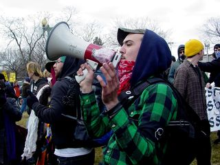 A person works the bullhorn to get the attention of the SDS crowd, so we could determine what we were going to do.