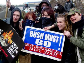 Meanwhile, some of the black bloc-ers posed for a photo...