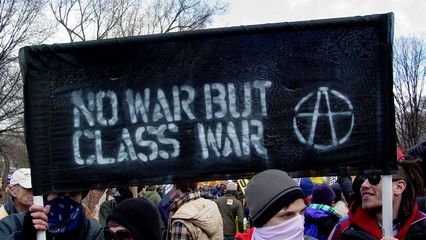 """This """"No war but class war"""" banner was one of the black bloc's larger banners."""