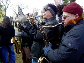 A few people in the anti-war crowd played musical instruments.