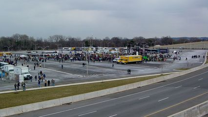All the while, the mainstream march group was continuing to arrive at the Pentagon's north parking lot.