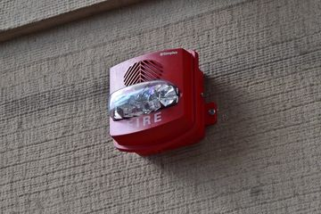 Weatherproof version of the Simplex TrueAlert horn/strobe on the exterior of the Ace Hotel.