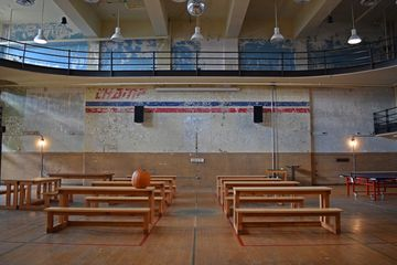 The old gym, with vintage paintwork, still in active use as an event space.