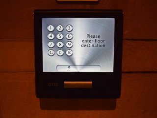 Touchscreen, where riders enter their destination floor, seen here on the main floor. Some floors used keypads instead of touchscreens, but the function is the same.