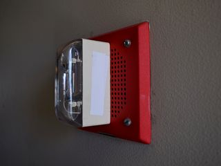 """The notification appliances, however, surprised me. They are Wheelock ET-1070-LSM-24, however, every strobe has white tape over the """"FIRE"""" lettering. No matter where it was in the building, """"FIRE"""" was taped over. When I later inquired with the university about this, the representative, from the facilities department, stated that this was done due to an unspecified manufacturer's design flaw."""