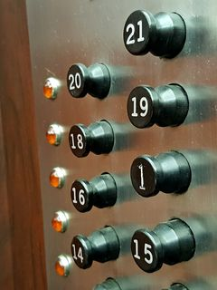 Before and after, showing the buttons for the 16th and 21st floors selected (left), and after they had reset (right).