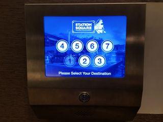 Touchscreen floor selector in the first floor elevator lobby.