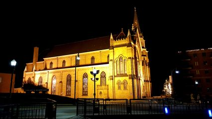 Saint Mary of the Mount Church, across the street from the overlook, lit up at night.