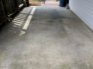The carport, before cleaning. My father washes cars in this area, and so this area sees a good bit of road dirt going onto it from that.